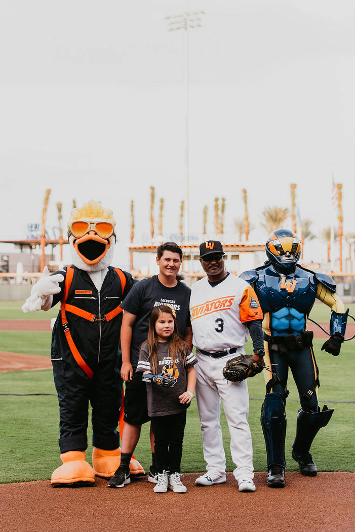 Hailey Dawson, 9, with mascots and other dignitaries at the season opener. (The Howard Hughes C ...