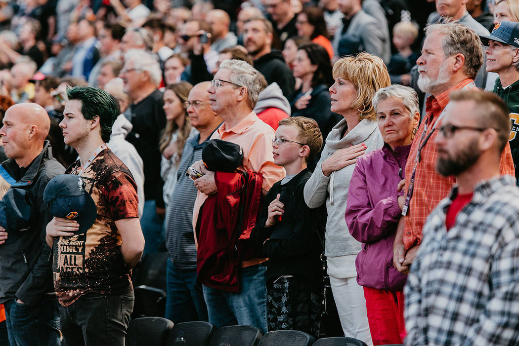 The crowd says the Pledge of Allegiance at April 9 season opener of the Las Vegas Aviators. (Th ...