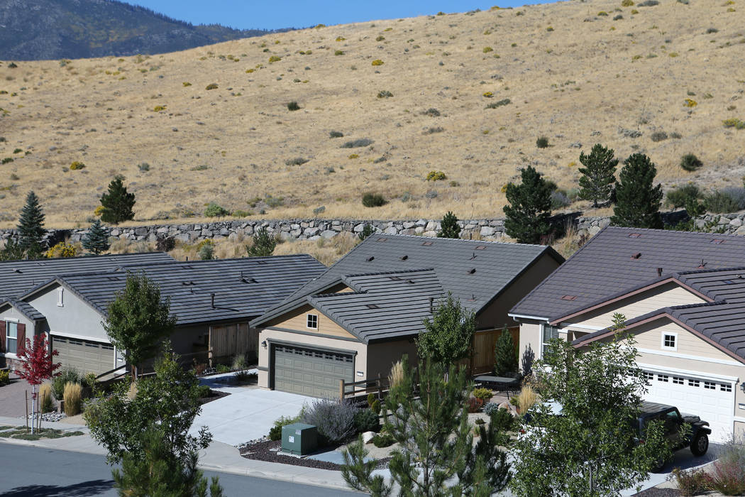 Stephen Paddock's home, center, sits empty in northwest Reno on Oct. 6, 2017. Cathleen Allison/ ...