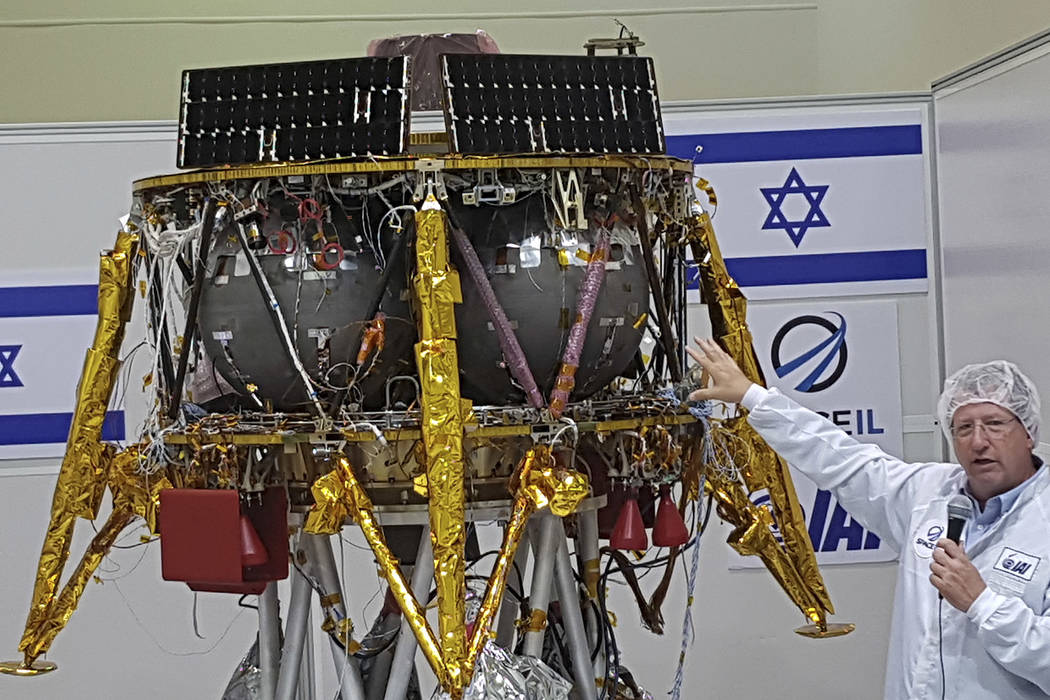 Opher Doron, general manager of Israel Aerospace Industries' space division, speaks beside the ...