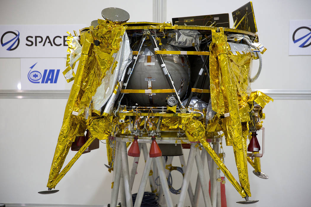 """This Dec. 17, 2018 file photo shows the SpaceIL lunar module in a special """"clean room"""" during a ..."""