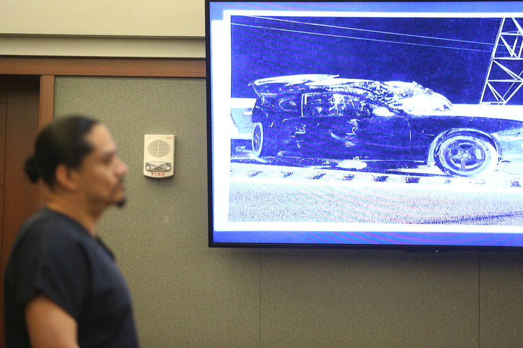 A photo of the victims's car is presented during the sentencing hearing for Antonio Macedo at t ...