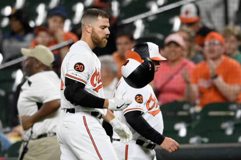 Baltimore Orioles' Chris Davis reacts after he struck out swinging during the eighth inning of ...