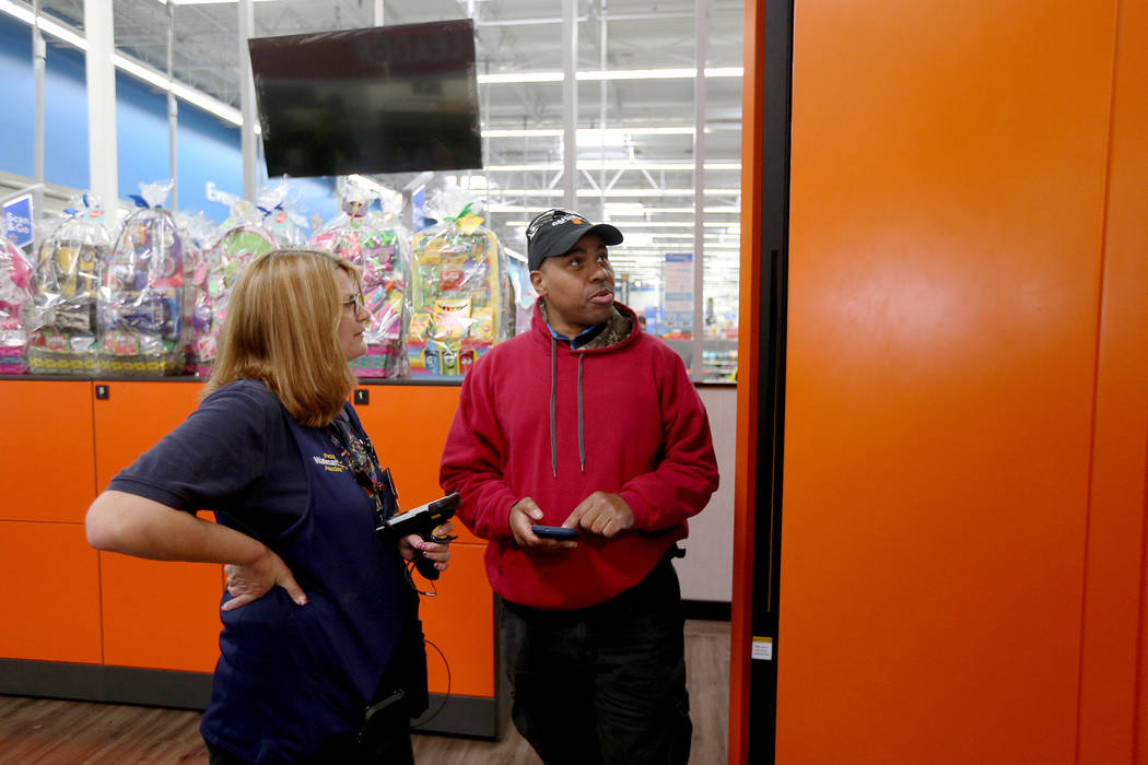 Walmart Associate Molly helps Harold Lloyd with the pickup tower at the Walmart in Henderson, T ...