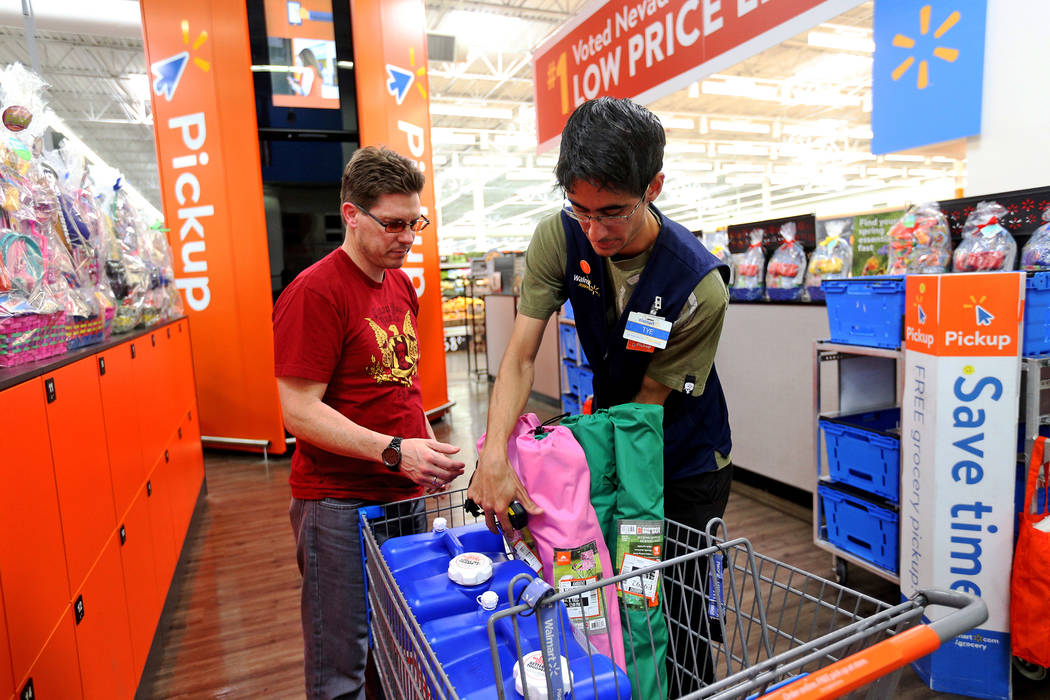 Walmart Associate Molly Tye Bonilla places items in Eric Viggiano's card that he ordered online ...