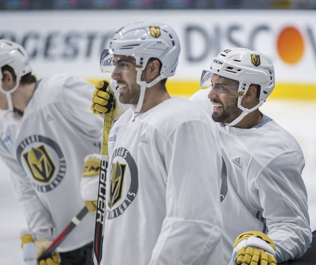 Golden Knights right wing Ryan Reaves, right, jokes around with teammate Alex Tuch during pract ...