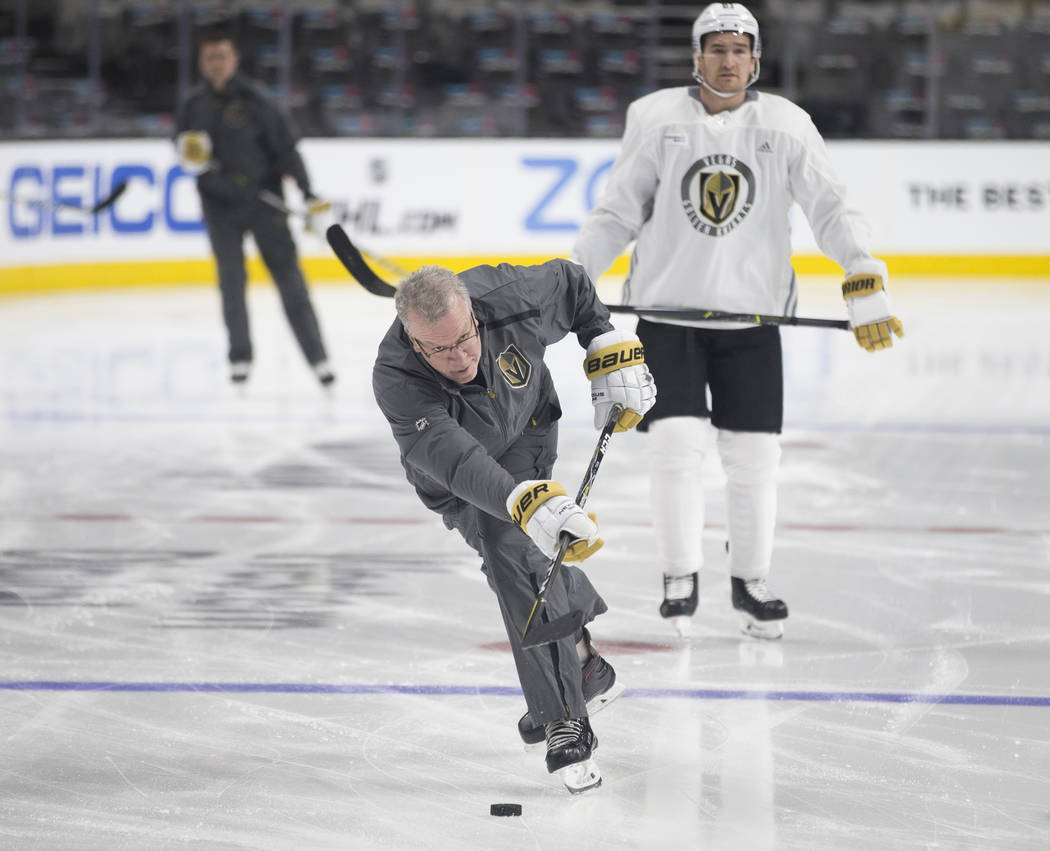 Golden Knights coach Ryan McGill warms up with his team during practice on Thursday, April 11, ...