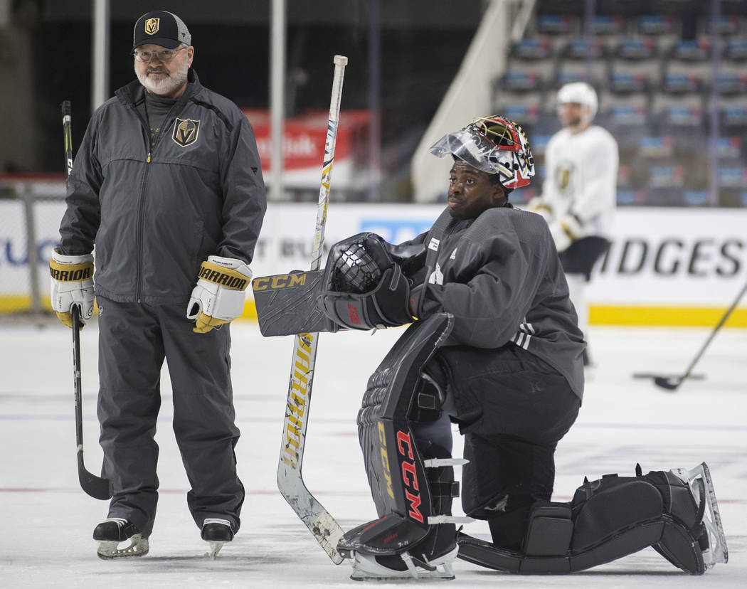 Golden Knights goaltender Malcolm Subban, right, takes a break during practice on Thursday, Apr ...
