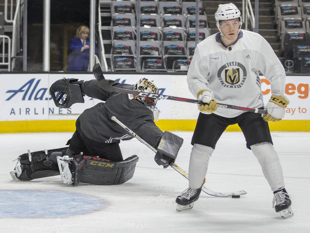 Golden Knights goaltender Malcolm Subban (30) makes a save during practice on Thursday, April 1 ...