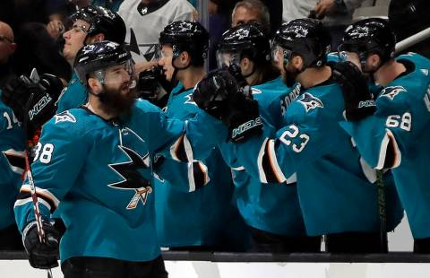 San Jose Sharks' Brent Burns, left, is congratulated for his goal against the Vegas Golden Knig ...