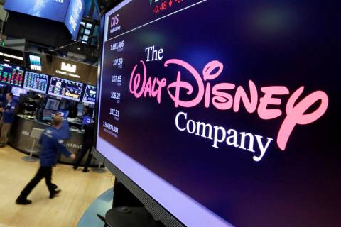 The Walt Disney Co. logo appears on a screen above the floor of the New York Stock Exchange. (A ...