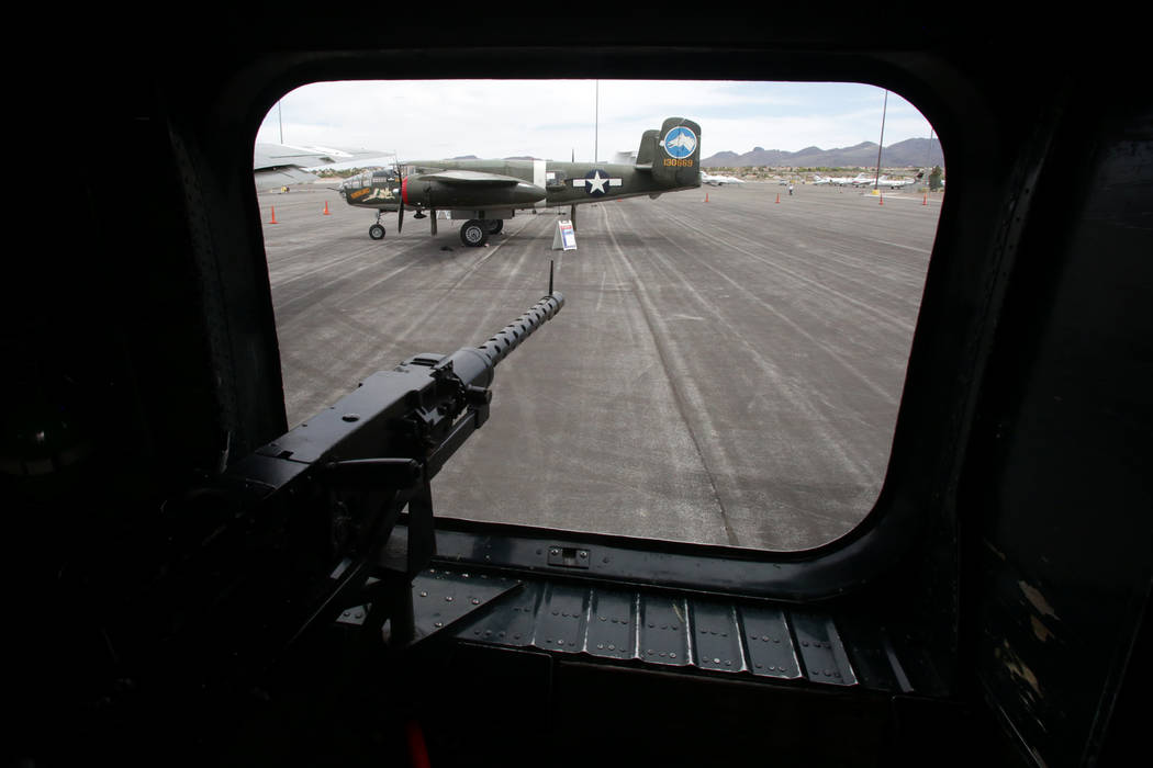 The view from a waist gunner's 50-caliber machinegun in a B-24J Liberator looks out at t ...