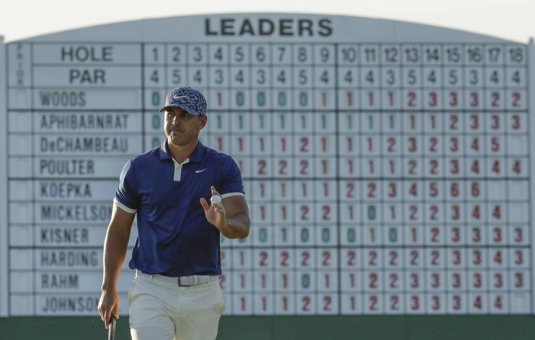 Brooks Koepka walks on the 17th hole during the first round for the Masters golf tournament Thu ...