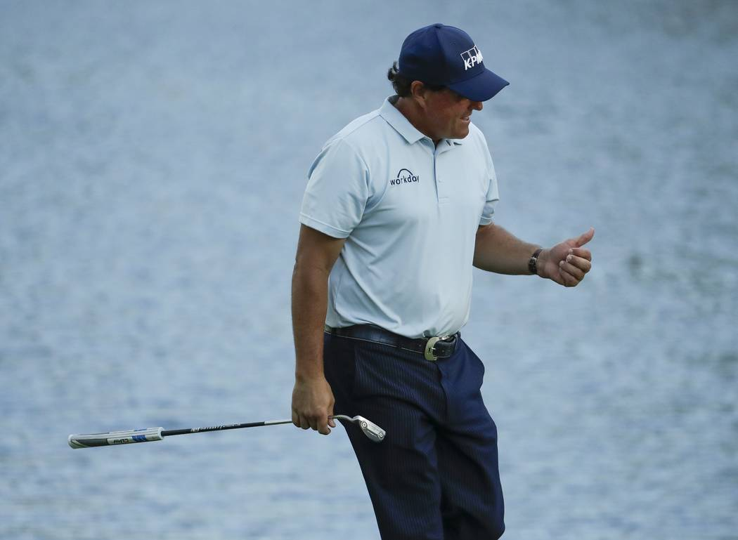 Phil Mickelson reacts after his birdie on the 16th hole during the first round for the Masters ...