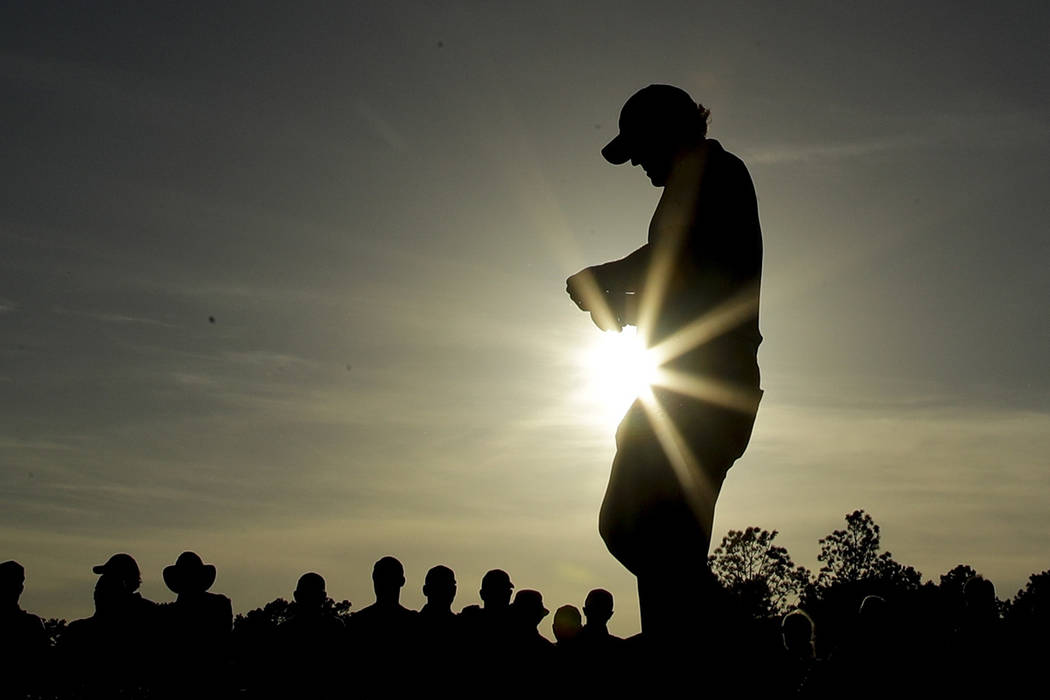 Phil Mickelson walks to the 18th tee during the first round for the Masters golf tournament Thu ...