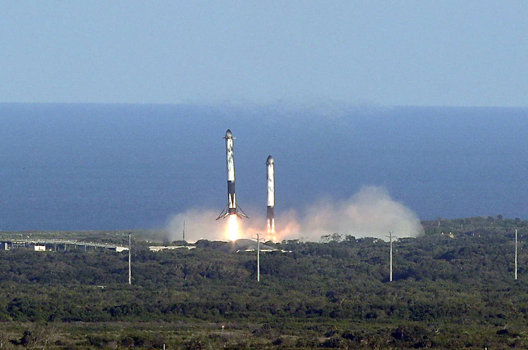 Eight minutes after liftoff, SpaceX lands two of the first-stage boosters side by side at the K ...