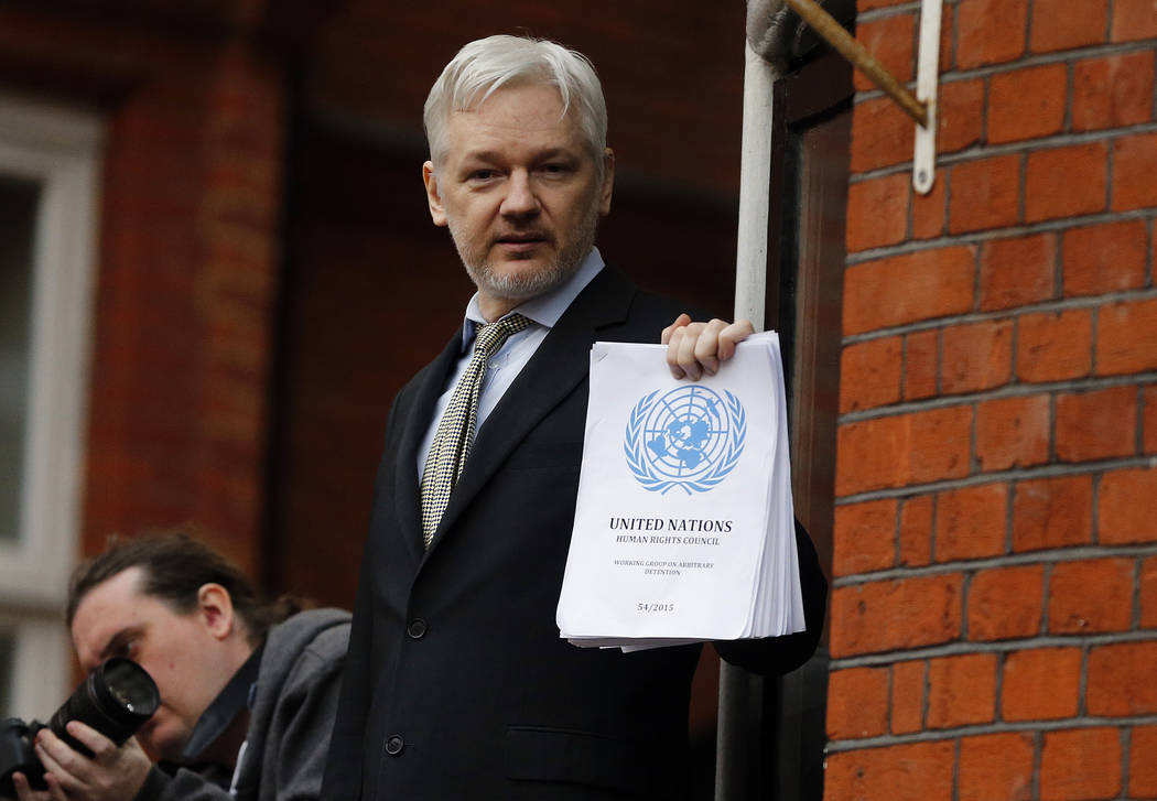 FILE - In this Friday, Feb. 5, 2016 file photo, WikiLeaks founder Julian Assange stands on the ...