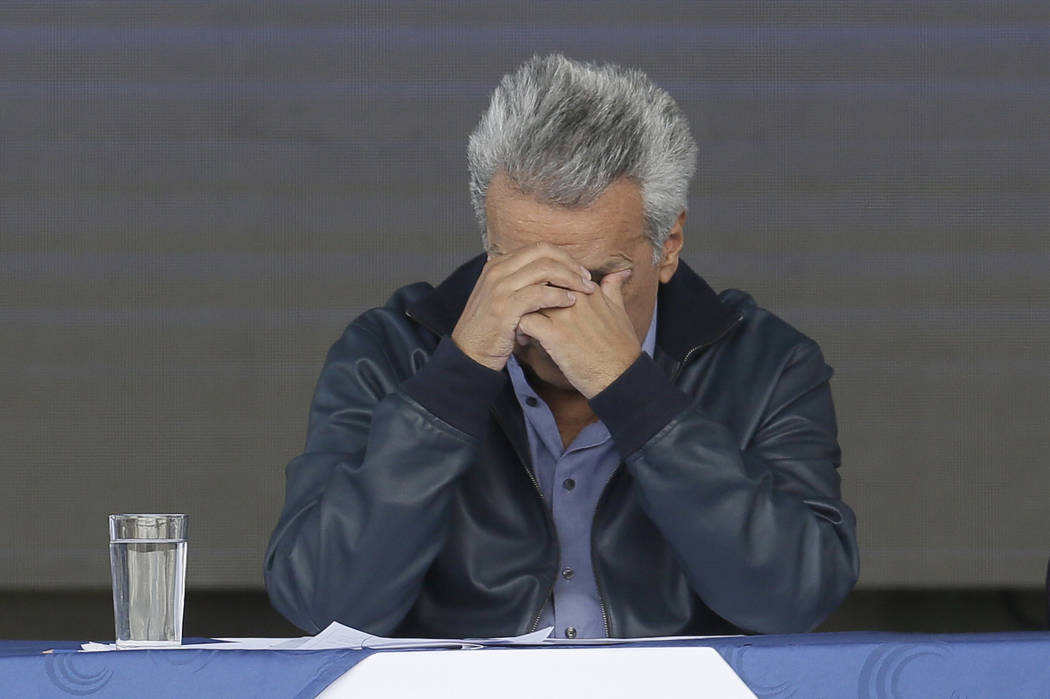 Ecuador's President Lenin Moreno rests his face in his hands during the inauguration of the &qu ...