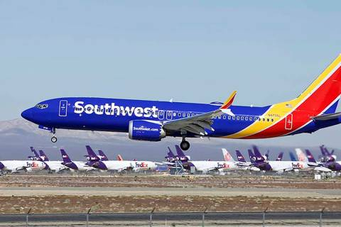 A Southwest Airlines Boeing 737 Max aircraft lands at Victorville, Calif., on March 23, 2019. S ...