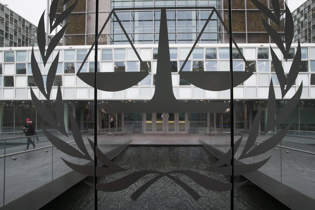 A person leaves the International Criminal Court in The Hague, Netherlands on Jan. 16, 2019. Ju ...