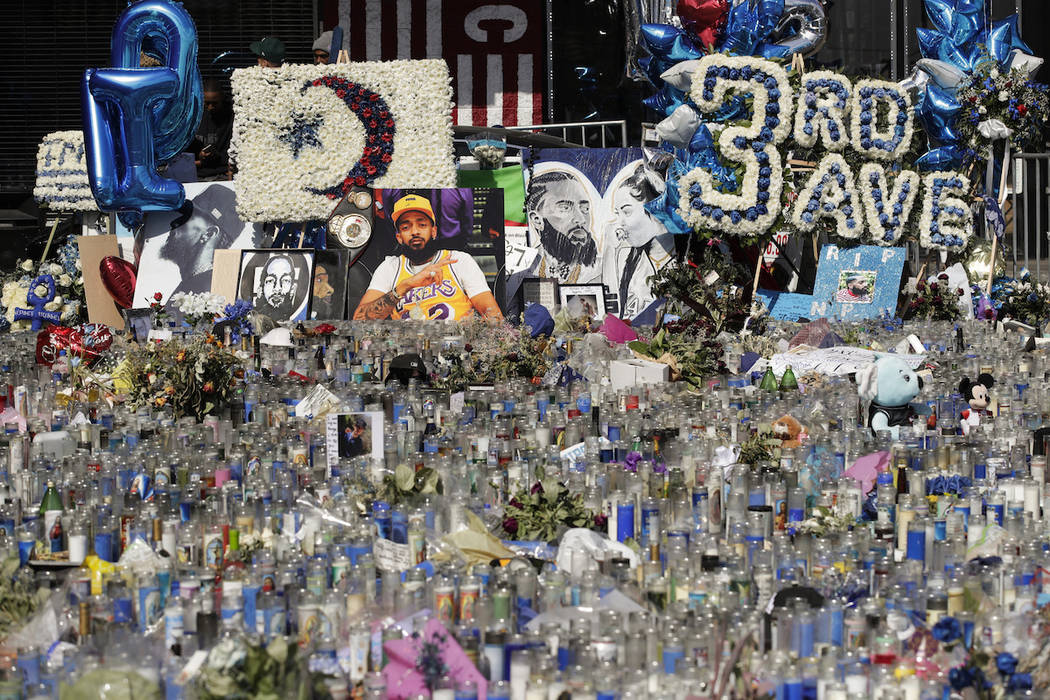 A makeshift memorial site for slain rapper Nipsey Hussle is filled with candles outside The Mar ...