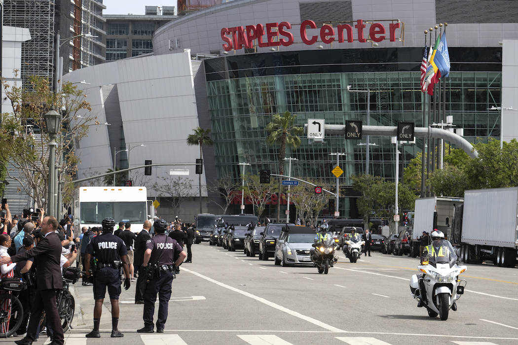 The hearse carrying rapper Nipsey Hussle leaves Staples Center after a public memorial in Los A ...
