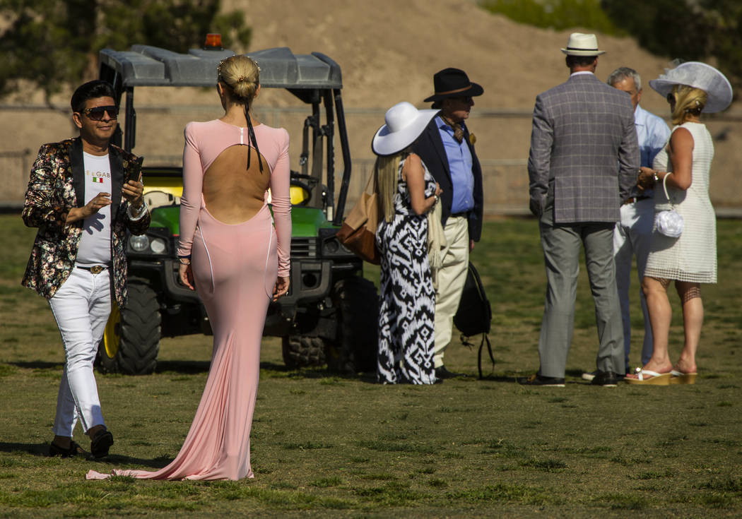 Guests chat on the grounds during the Las Vegas Polo Classic at Star Nursery Field on Saturday, ...