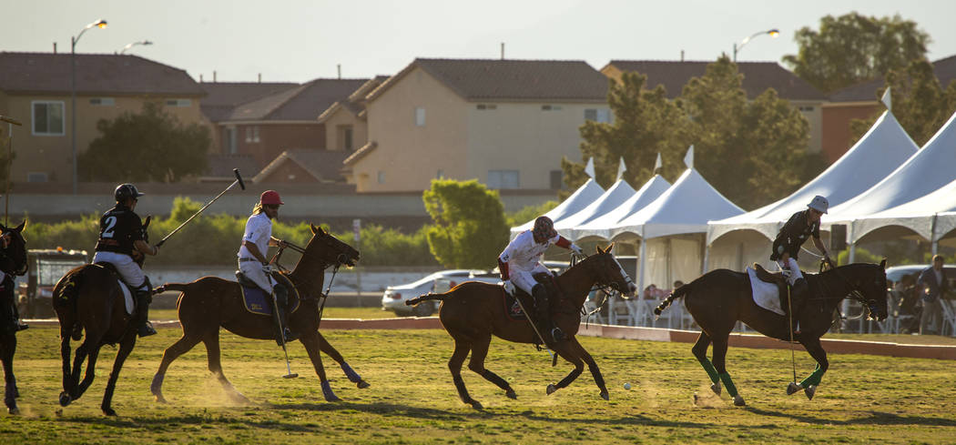 Blue Heron battles UBS Financial Services during their match at the Las Vegas Polo Classic at S ...
