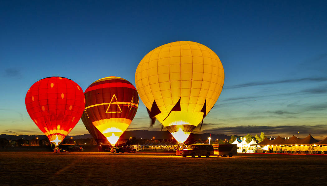 A balloon glow completes the night to live music during the Las Vegas Polo Classic at Star Nurs ...