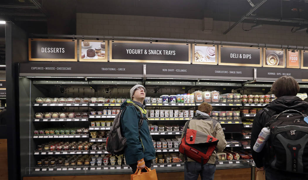 FILE - In this Jan. 22, 2018, file photo, a customer looks overhead in an Amazon Go store, wher ...