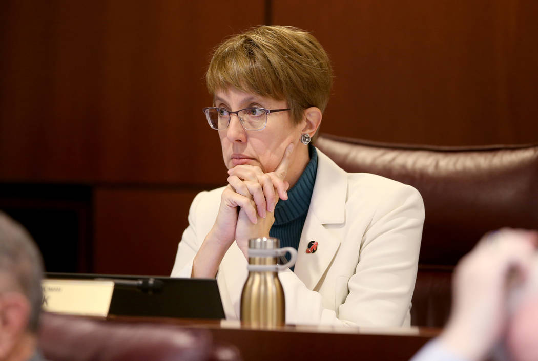 Assemblywoman Heidi Swank, D-Las Vegas, listens to a presentation during a Ways and Means Commi ...