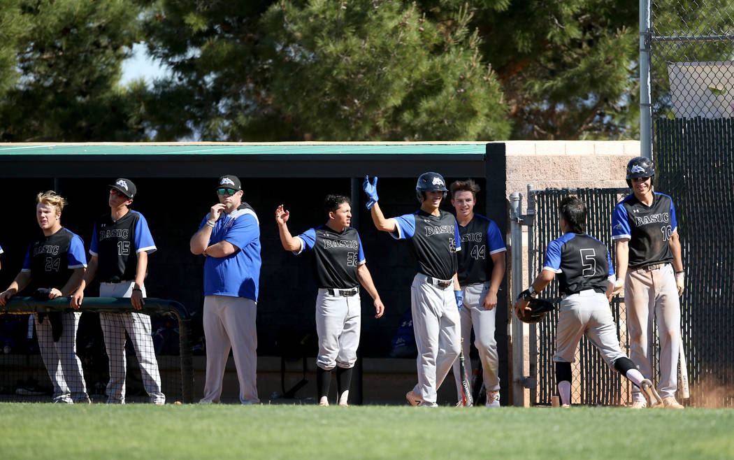 Basic's Dominik Tavares (5) is congratulated by his teammates after scoring against Palo Verde ...