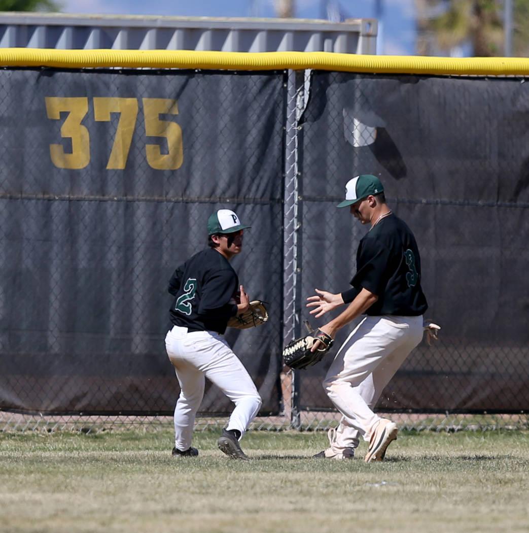 Palo Verde left fielder Matthew Minkoff (2) brings in a Basic fly ball in front of center field ...
