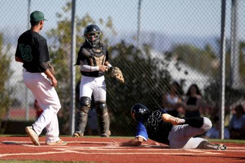 Basic's Logan Spaur (32) scores as Palo Verde catcher Yuta Nakamura holds the throw to pitcher ...