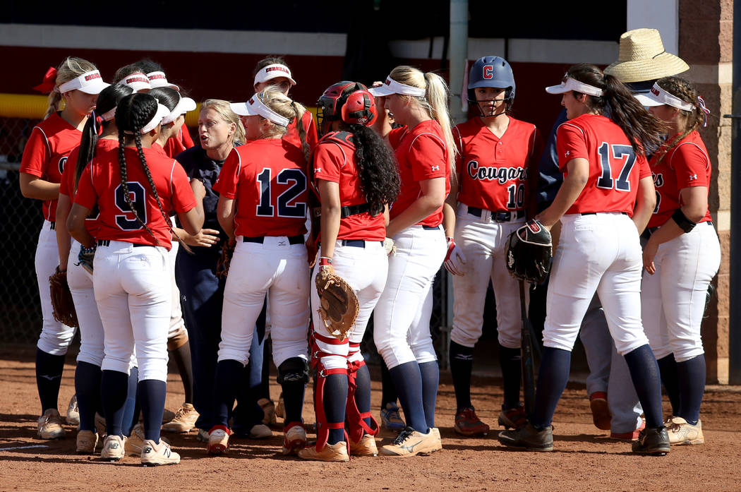 Coronado players, including outfielder Kaila Angel (9) and shortstop Paige Sinicki (12) get ins ...