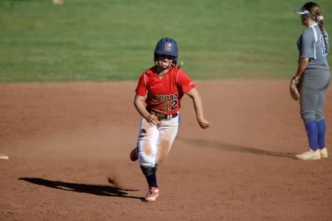 Coronado shortstop Paige Sinicki (12) heads for third base during a softball game against Basic ...
