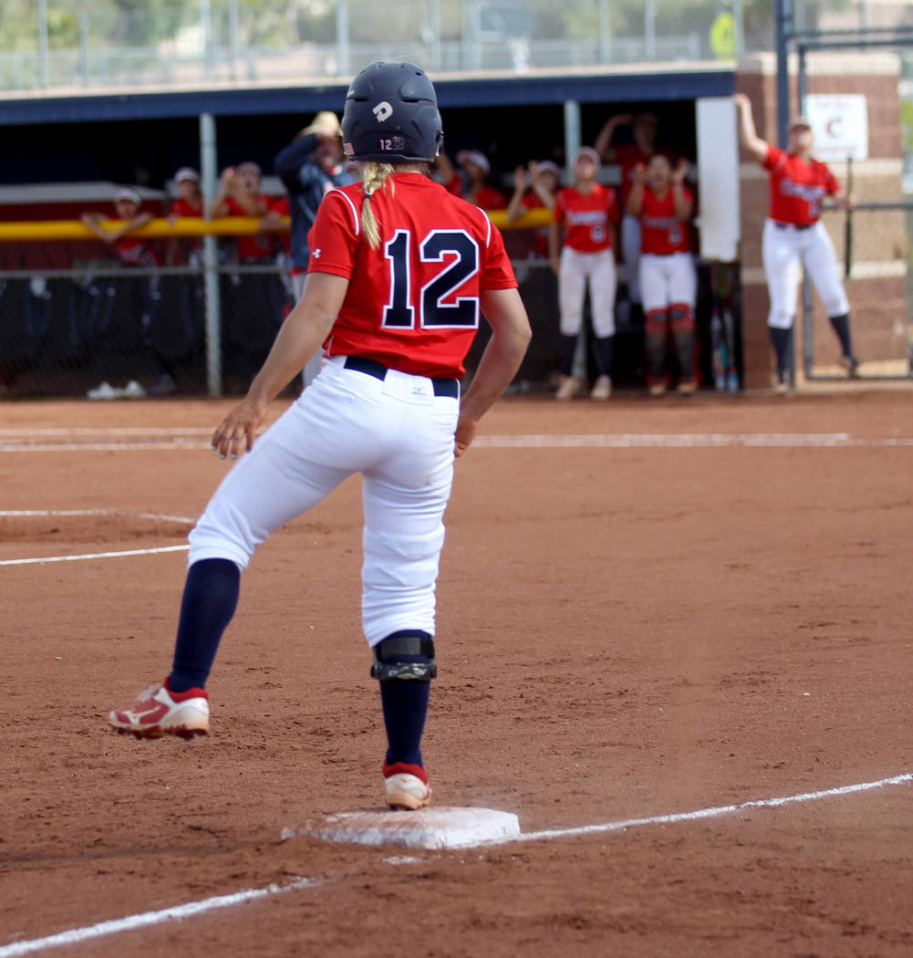 Coronado baserunner Paige Sinicki (12) reacts to her teammates after hitting a triple in the fi ...