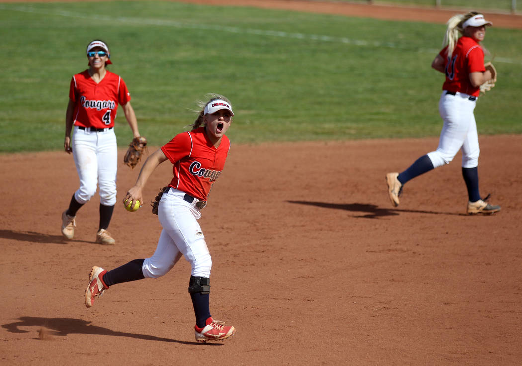 Coronado shortstop Paige Sinicki (12) reacts after tagging out a Basic baserunner during their ...