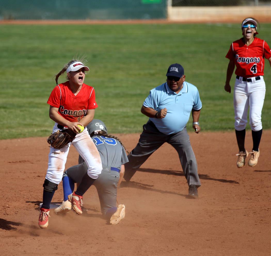 Coronado shortstop Paige Sinicki (12) and Aleah Baldonado (4) celebrate after Sinicki tagged ou ...