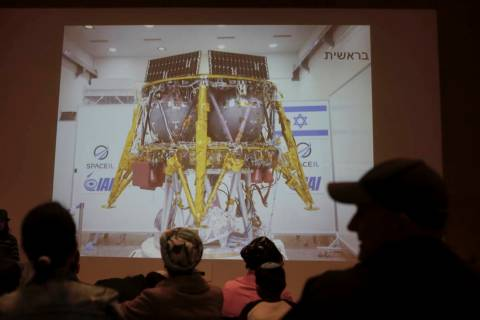 People watch the live broadcast of the SpaceIL spacecraft as it lost contact with Earth in Neta ...