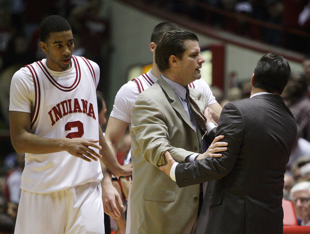 Indiana coach Tom Crean, right, is held back by assistant Tim Buckley after Crean received his ...
