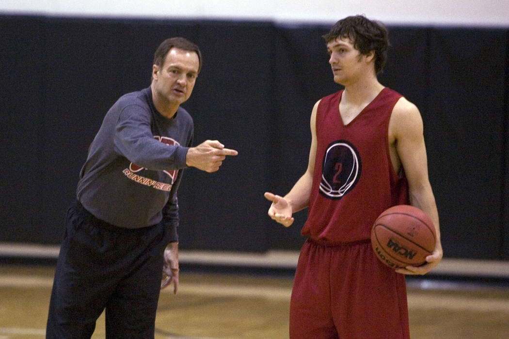 K.M. CANNON/REVIEW-JOURNAL UNLV Head Coach Lon Kruger gives instruction is son, point guard Kev ...