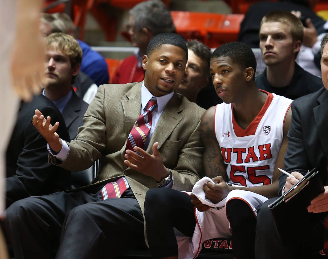 Utah assistant coach DeMarlo Slocum talks with Delon Wright as the University of Utah defeats G ...