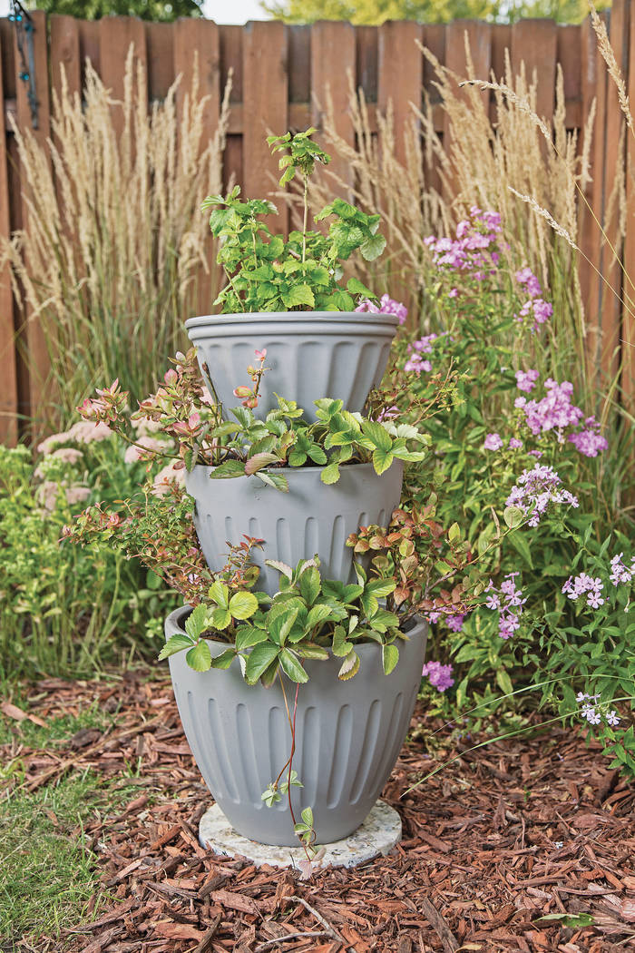 What better way to put those extra planters to use than to create a stocked pot tower garden? N ...