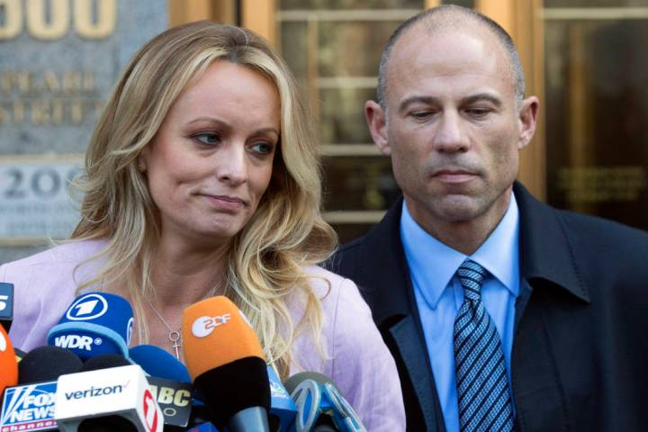 Stormy Daniels, left, stands with her lawyer Michael Avenatti as she speaks outside federal cou ...