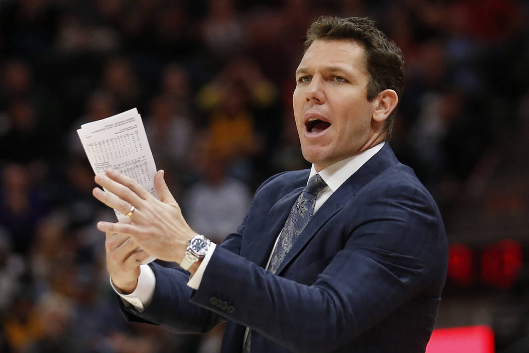 Los Angeles Lakers head coach Luke Walton shouts to his team in the second half during an NBA b ...