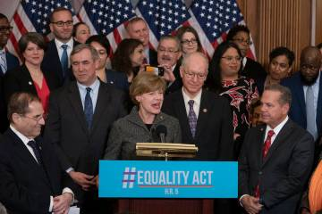 Sen. Tammy Baldwin, D-Wis., flanked by House Judiciary Committee Chairman Jerrold Nadler, D-N.Y ...