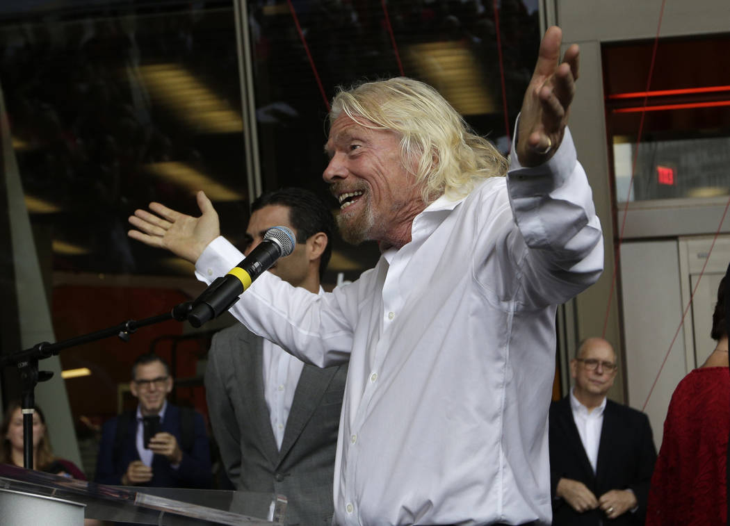 Richard Branson, of Virgin Group, speaks during a naming ceremony for the Brightline train stat ...