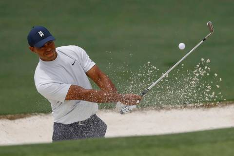 Tiger Woods hits from a bunker on the second hole during the second round for the Masters golf ...