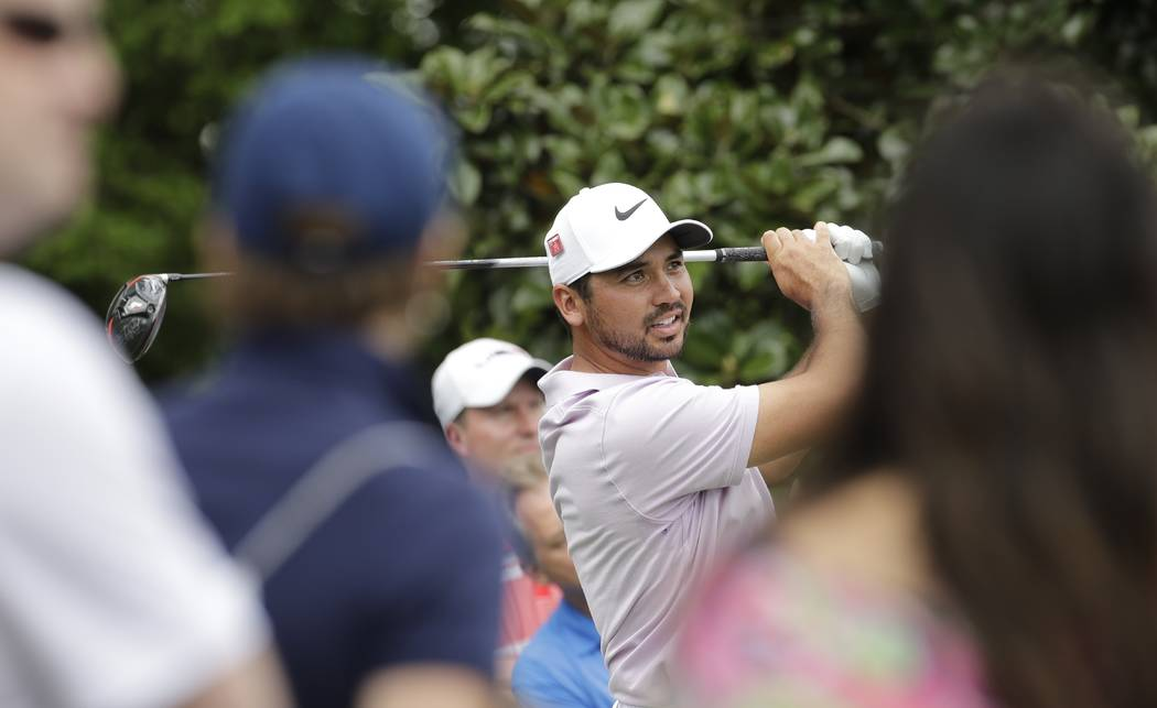Jason Day, of Australia, hits a drive on the ninth hole during the second round for the Masters ...